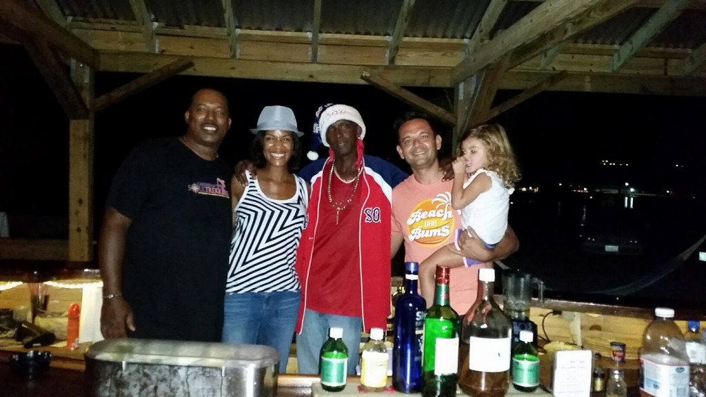 Hanging out with our friends Caribbean Soul Trekkers and King Elvis at his beach bar in Anguilla.