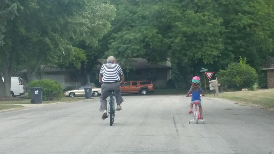 My daughter and her grandfather enjoying a bike ride together.