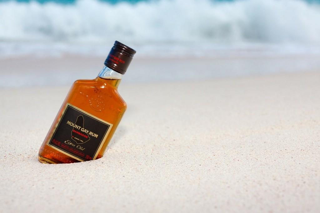 Bottle of rum on the beach.