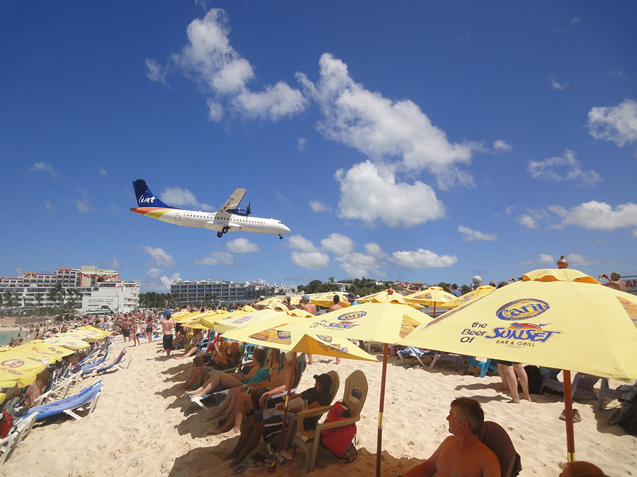Plane flying over Maho Beach on approach at Princess Juliana Airport (SXM) in St. Maarten