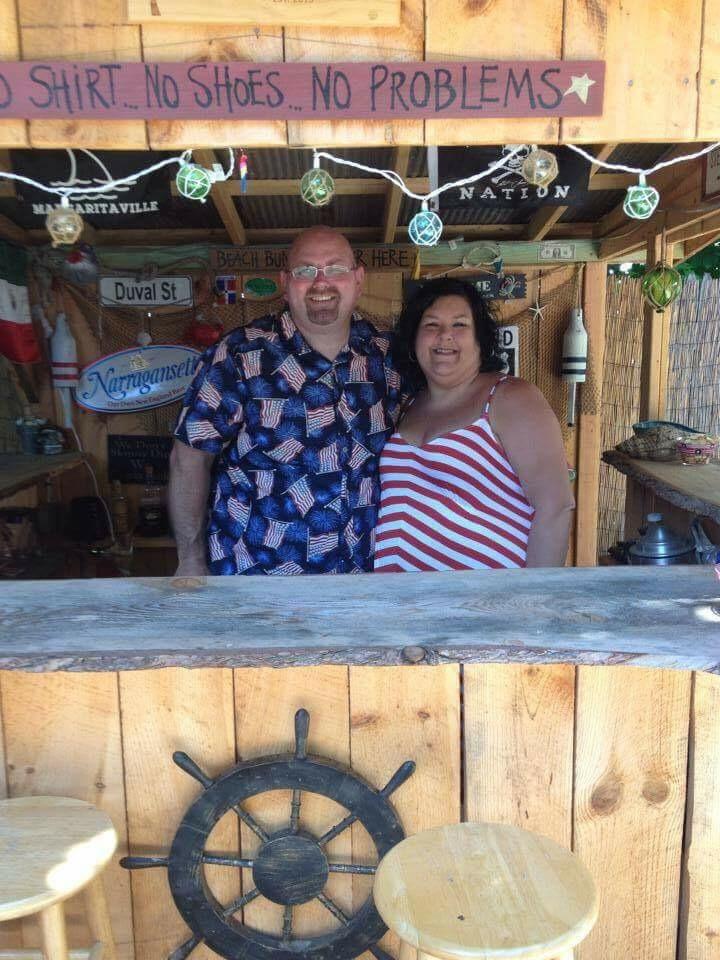 Manning the station at their backyard beach bar