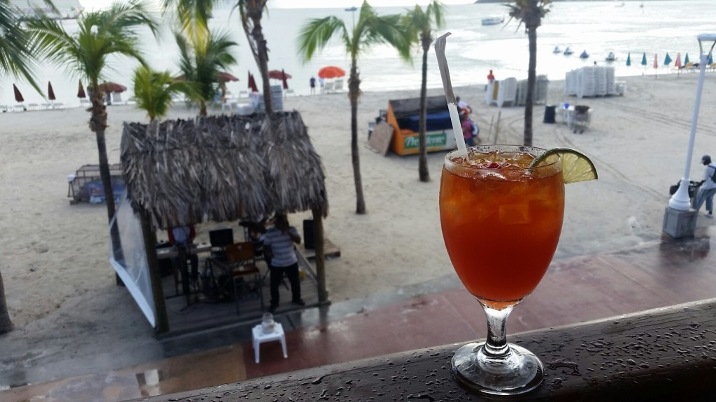 A rum punch enjoying the view over the Philipsburg boardwalk in St. Maarten.