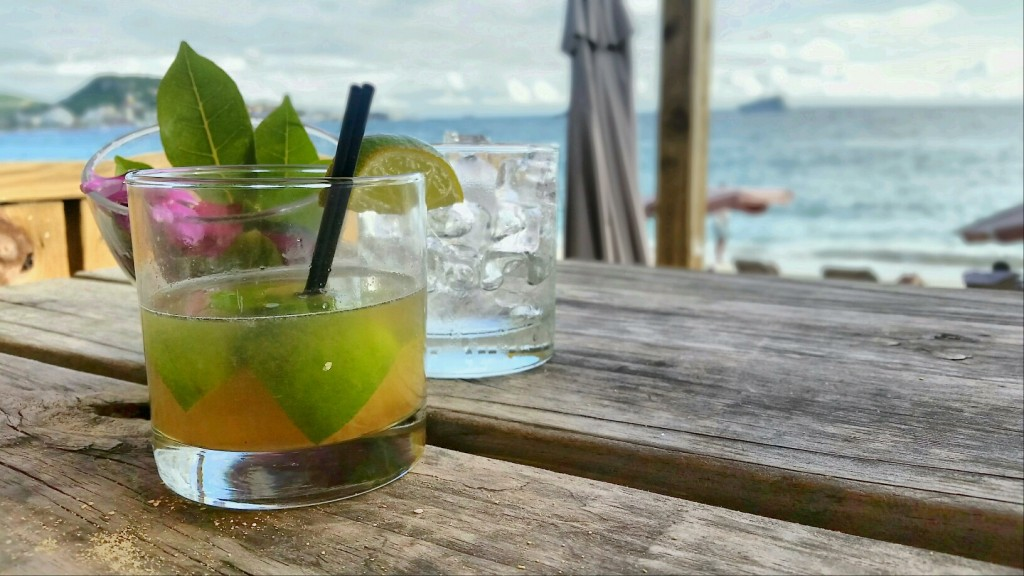 Posing my ti punch at Karakter Beach Bar in St. Maarten. If you've ever had one, you'll understand the need for the ice cubes.
