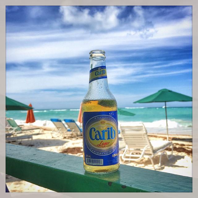 Posing a Carib at Uncle Ernie's beach bar in Anguilla. Photo credit https://instagram.com/cjlundegard