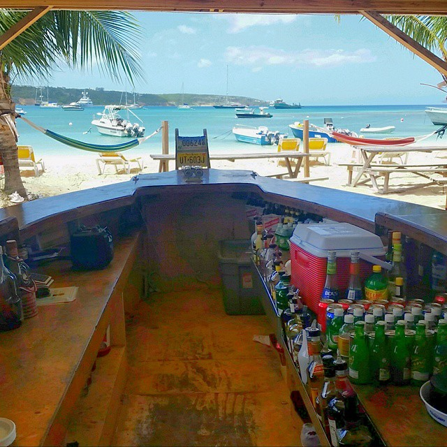 Behind the bar at Elvis' beach bar, Sandy Ground, Anguilla.