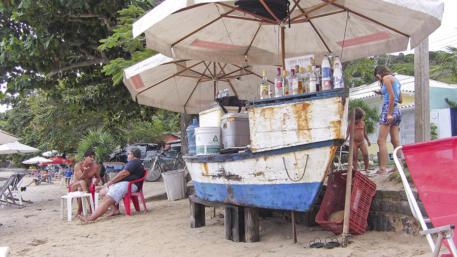 Boat turned beach bar on Ossos Beach, Brazil. Photo by Flickr user edoaracena