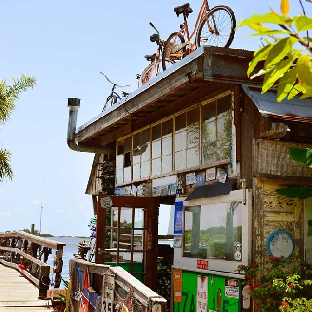 Bikes make their stand on the roof at Hideaway Tiki Bar, Cedar Key, Florida.  Photo by Instagram user @beachesbarsandbugalows