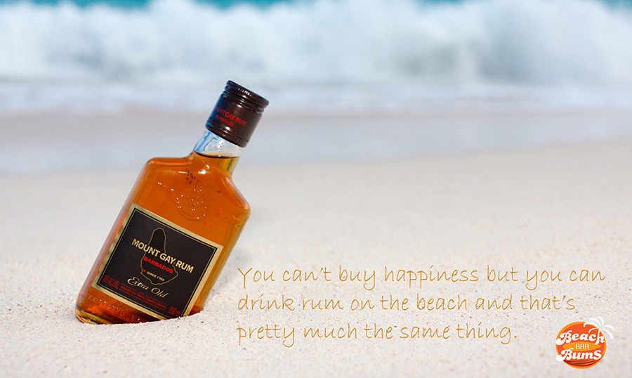 Bottle of rum on the beach