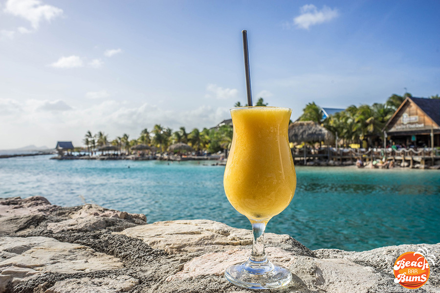 Passion Fruit cocktail enjoying a view of Hemingway Beach Bar in Curacao