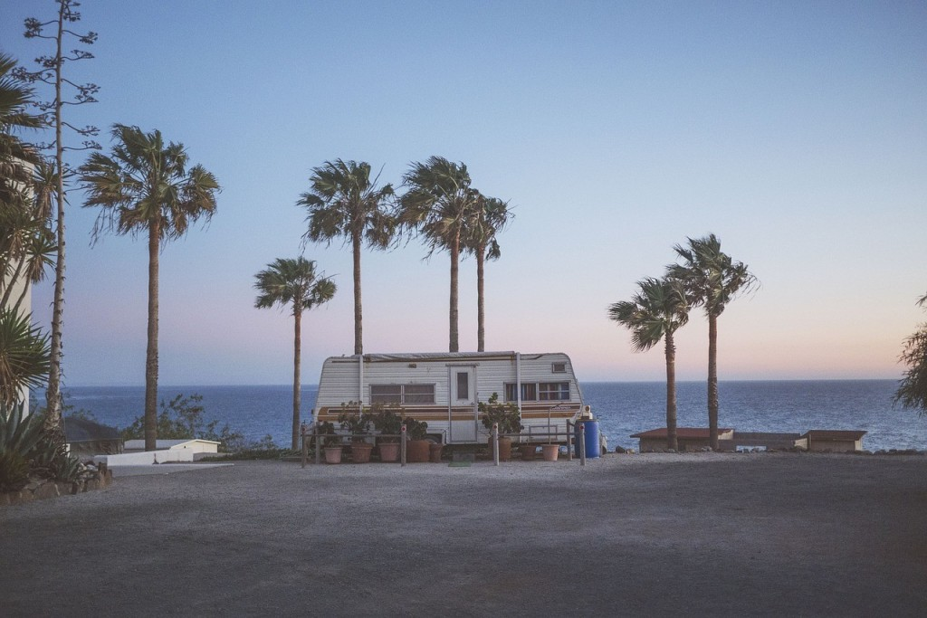 Van on the coast with palm trees