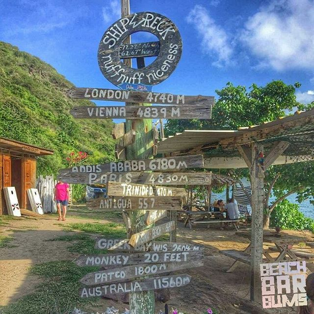 The sign at Shipwreck Beach Bar in St. Kitts is a reminder of how far you are from home or how close the monkeys always are.